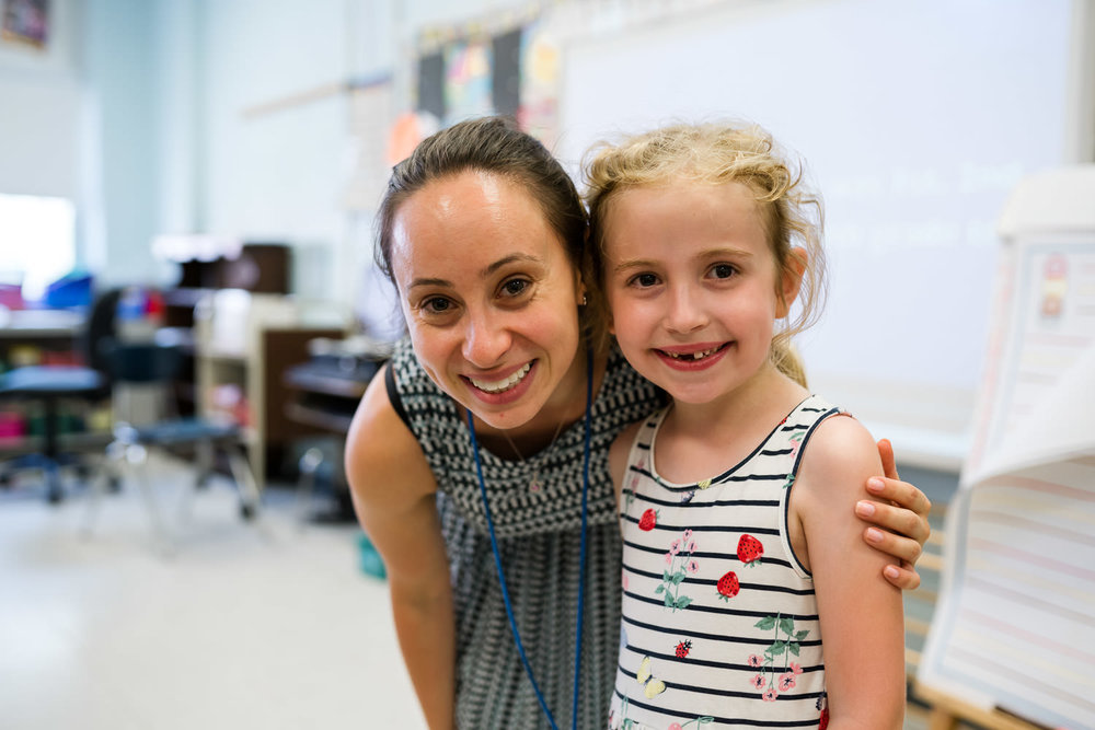 A little girl and her teacher.