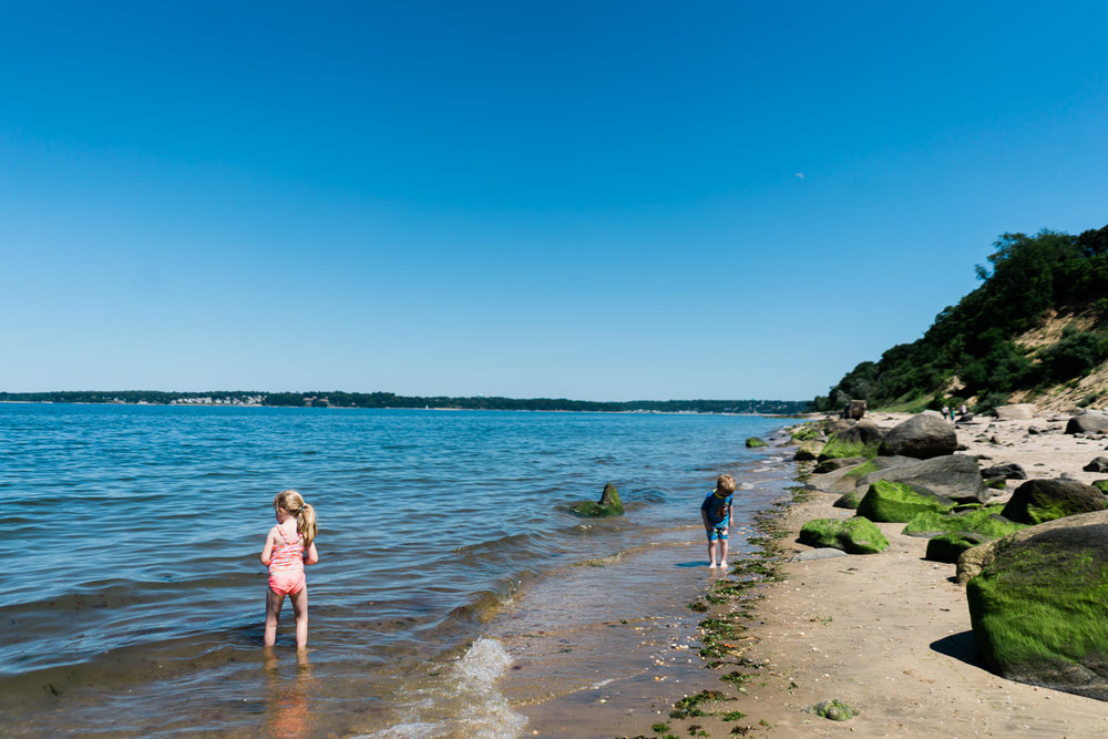 A little boy and girl play at Sands Point Beach.