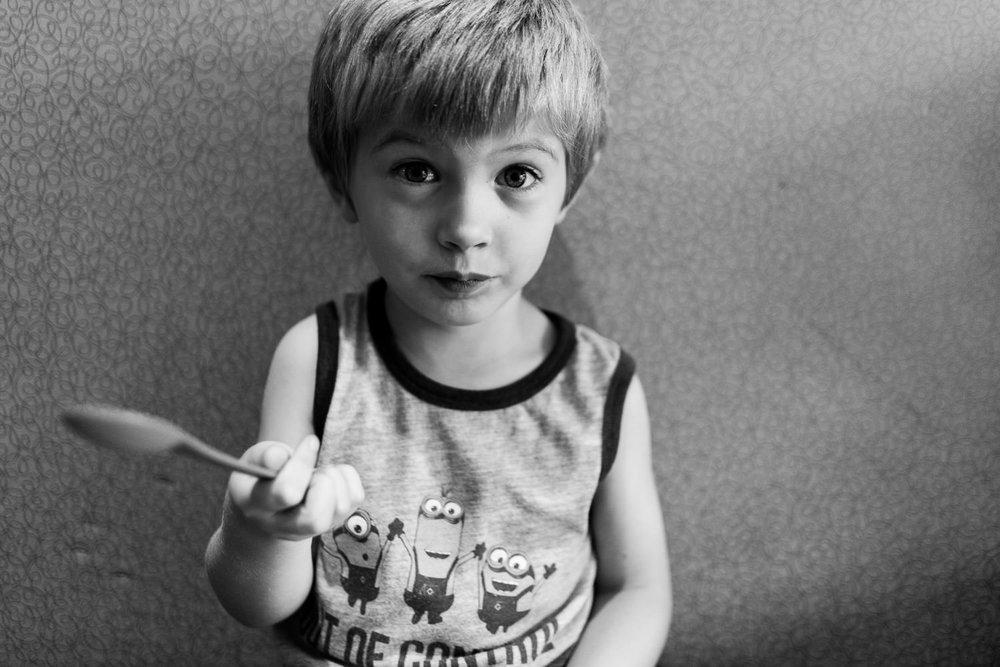 A little boy at a frozen yogurt shop.