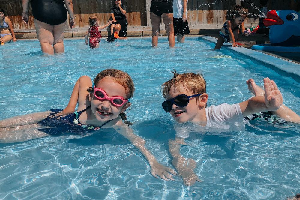 Kids swim in the town pool.