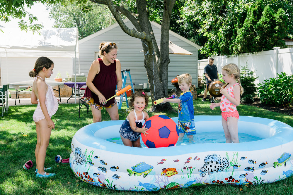 Children play in a kiddie pool.