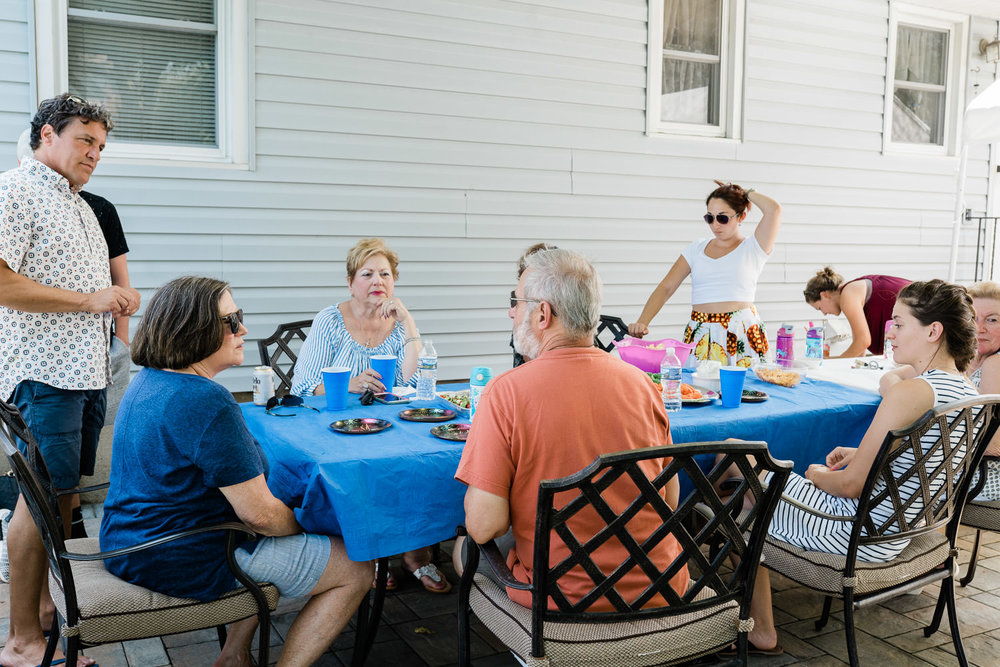 Family members gather for a BBQ.