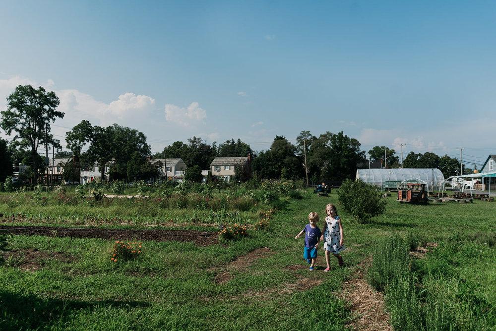 Two kids walk through the fields at Crossroads Farm.