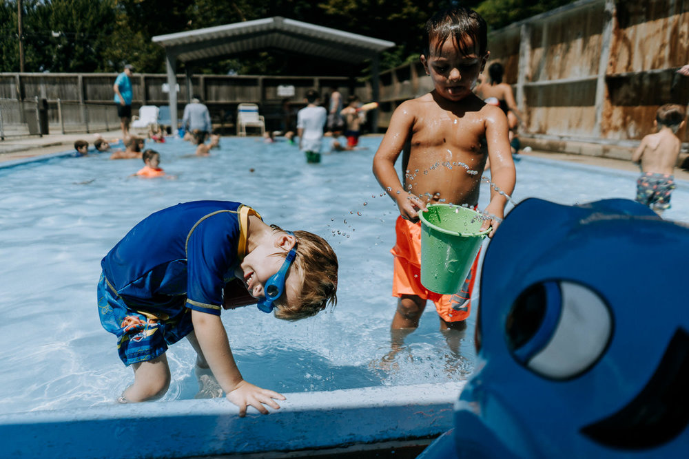 Two little boys play in the kiddie pool at Rath Park.