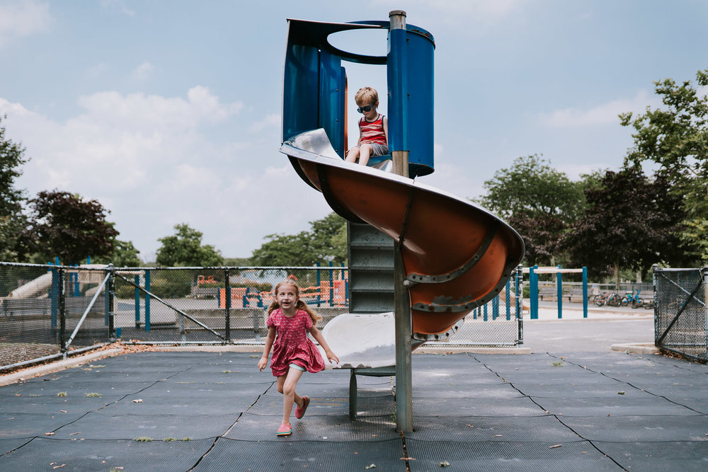 Kids play on a slide at Wantagh Park.