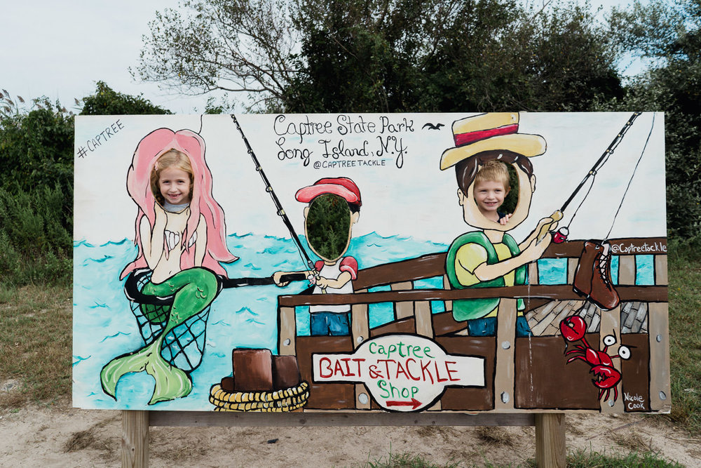 Children pose in a cut out side at Captree State Park.