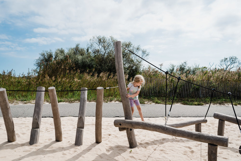 A little girl plays at Captree State Park.