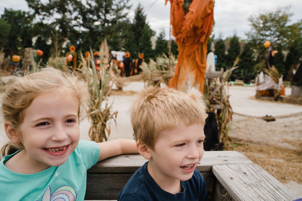 Two kids enjoy a hayride at Hicks Nursery.