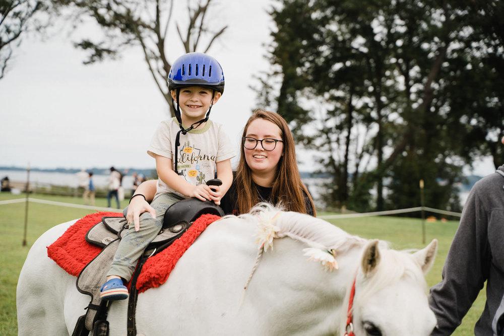 A little boy rides a pony at Sands Point Preserve.