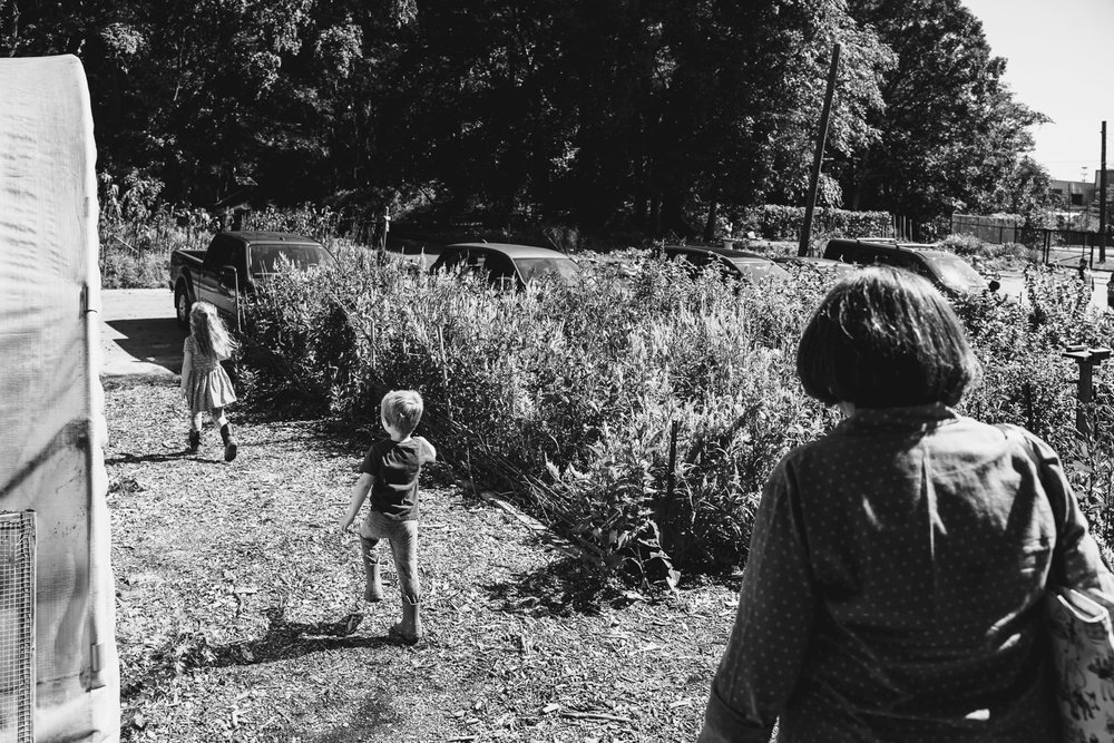 Kids walk through the flower field at Restoration Farm.