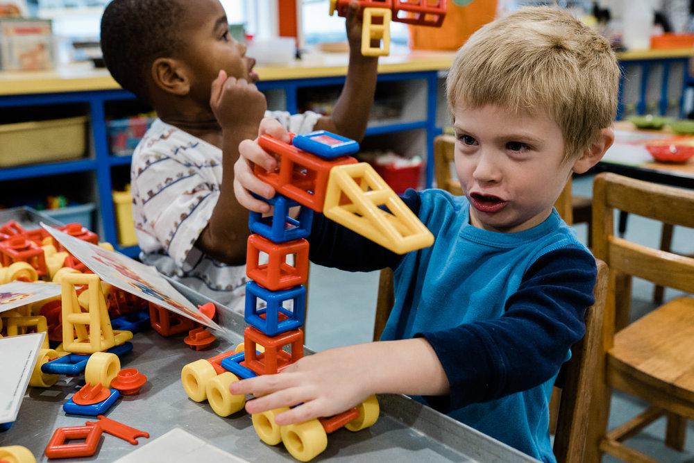 Preschoolers play with blocks.