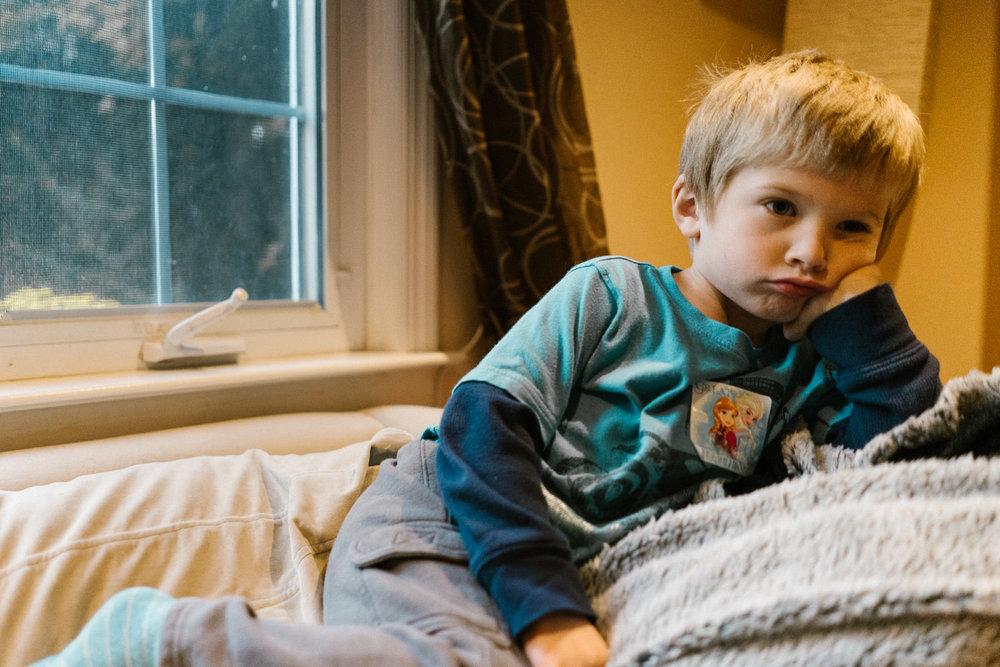 A little boy looks grumpy.