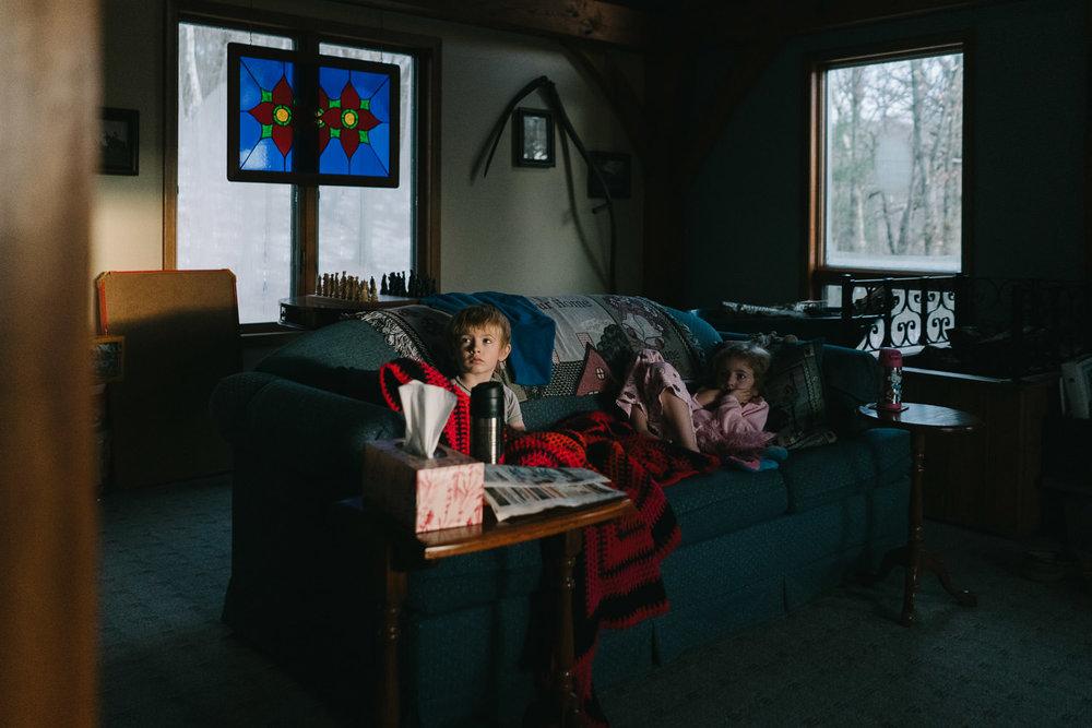 Two children watch a movie.