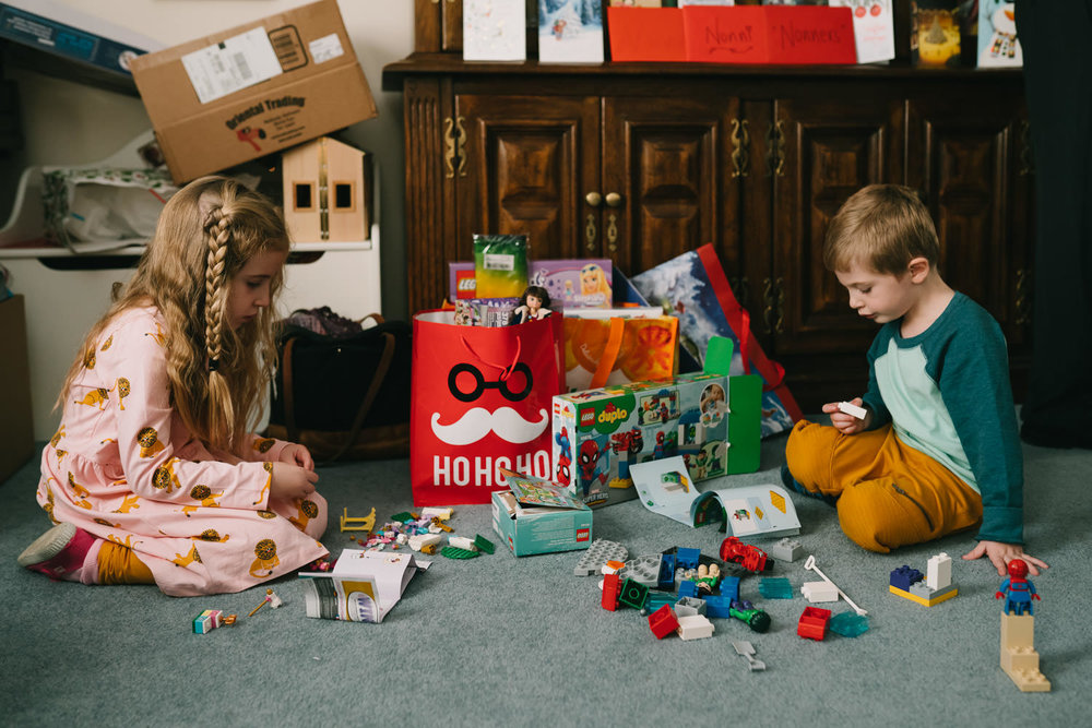 Children play with legos on Christmas.