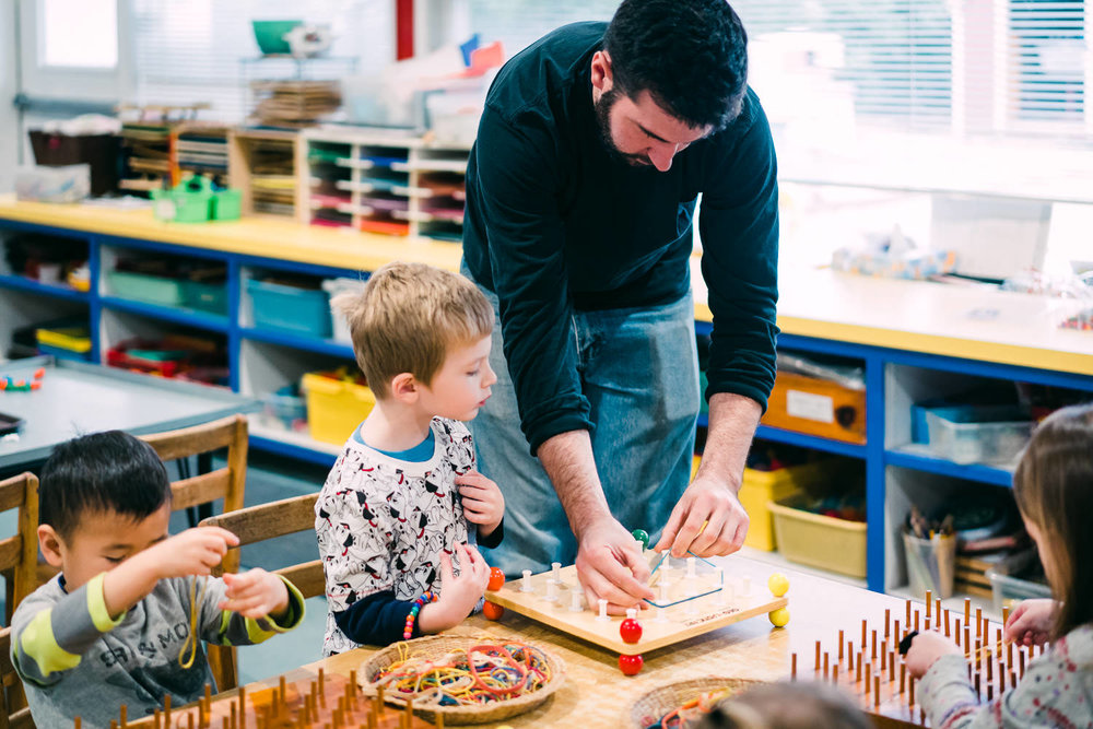 A father helps out in his son's classroom.