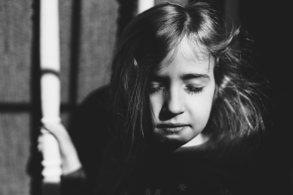 A portrait of a little girl in black and white.