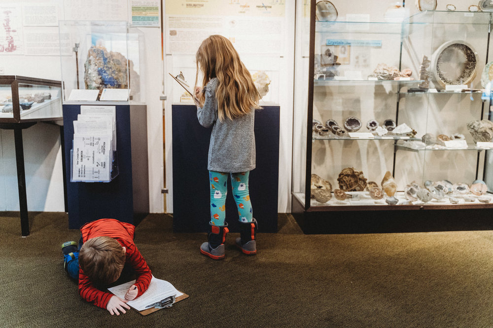 Two kids do a scavenger hunt at Garvies Point Museum.