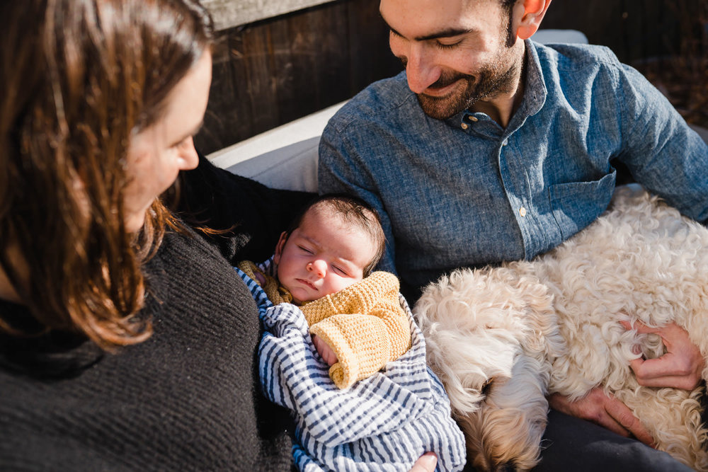New parents smile at their baby son.