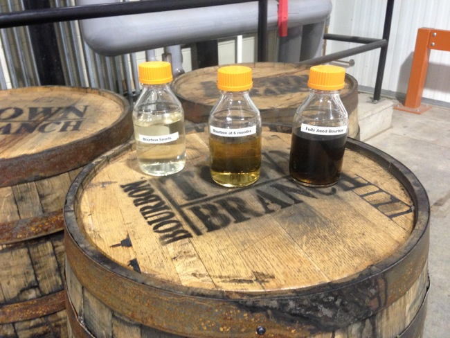 This display shows the effect of barrel aging on bourbon.  From left to right you see bourbon fresh off of the still, at six months, and at two years.