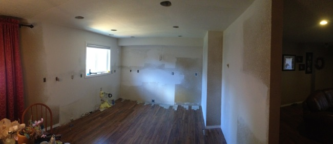 As you can see we filled in the flooring where the peninsula used to be, and this picture was taken after the drywall was completed.