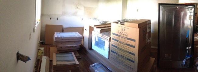 Piles of cabinets and appliances waiting for installation day.
