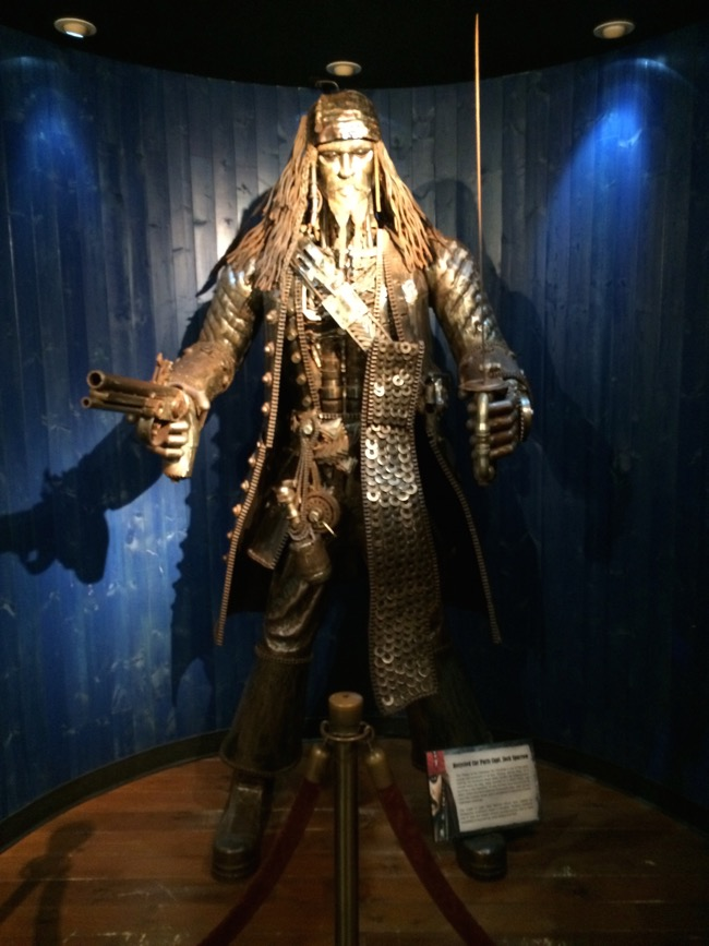 This 8 foot tall statue of Capt. Jack sparrow from Pirates of the Caribbean is made of recycled car parts!