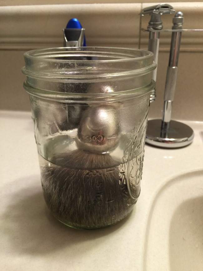 Step Two: Prep your shaving brush by soaking it in warm water to soften the bristles
