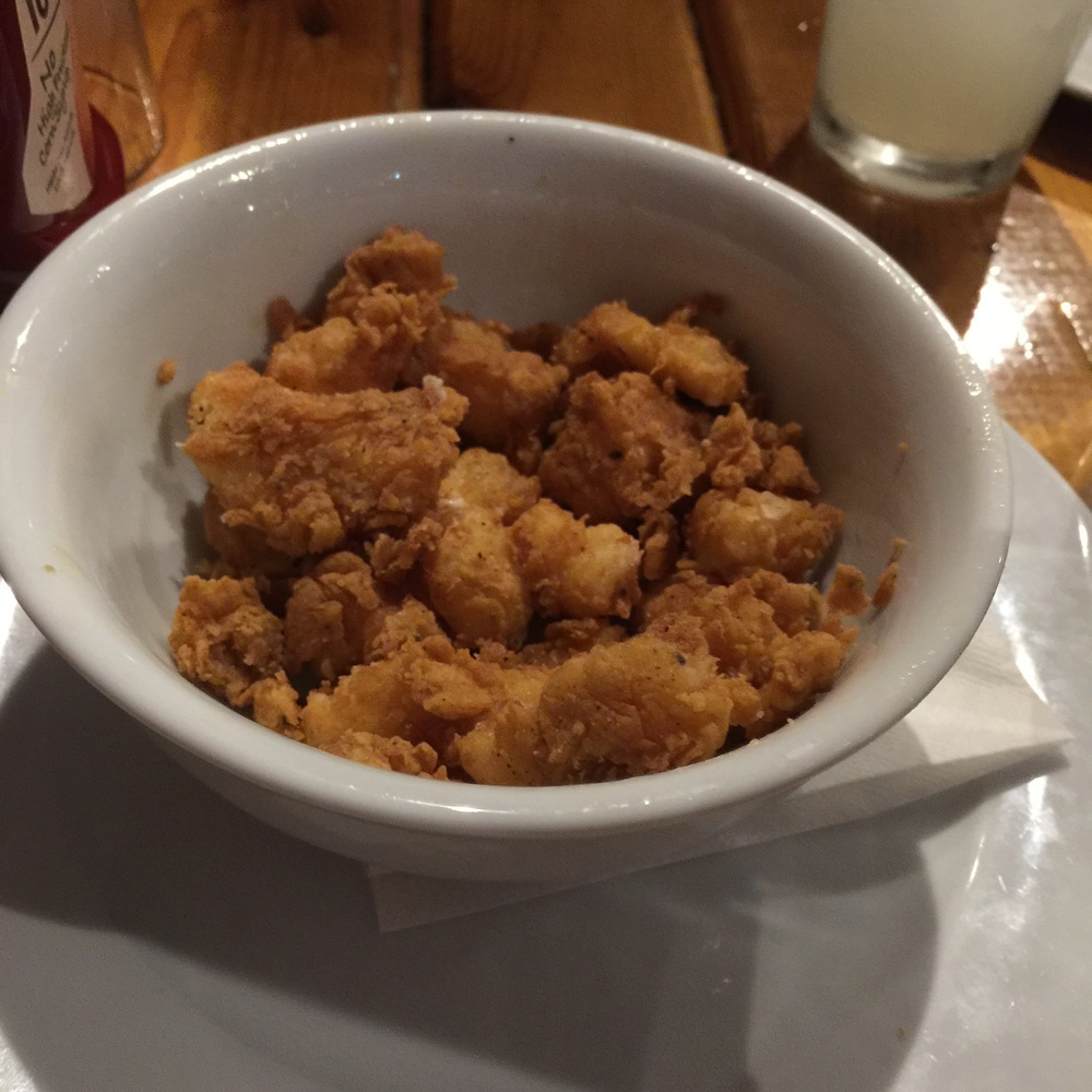 The fried cheese curds are served in a large bowl.  Plenty to share and perfectly breaded and prepared.