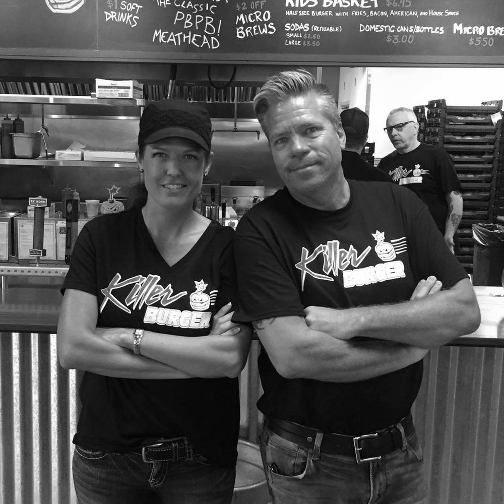 Coral and Wes Welterman pose in front of the kitchen at Killer Burger - Sunnyside