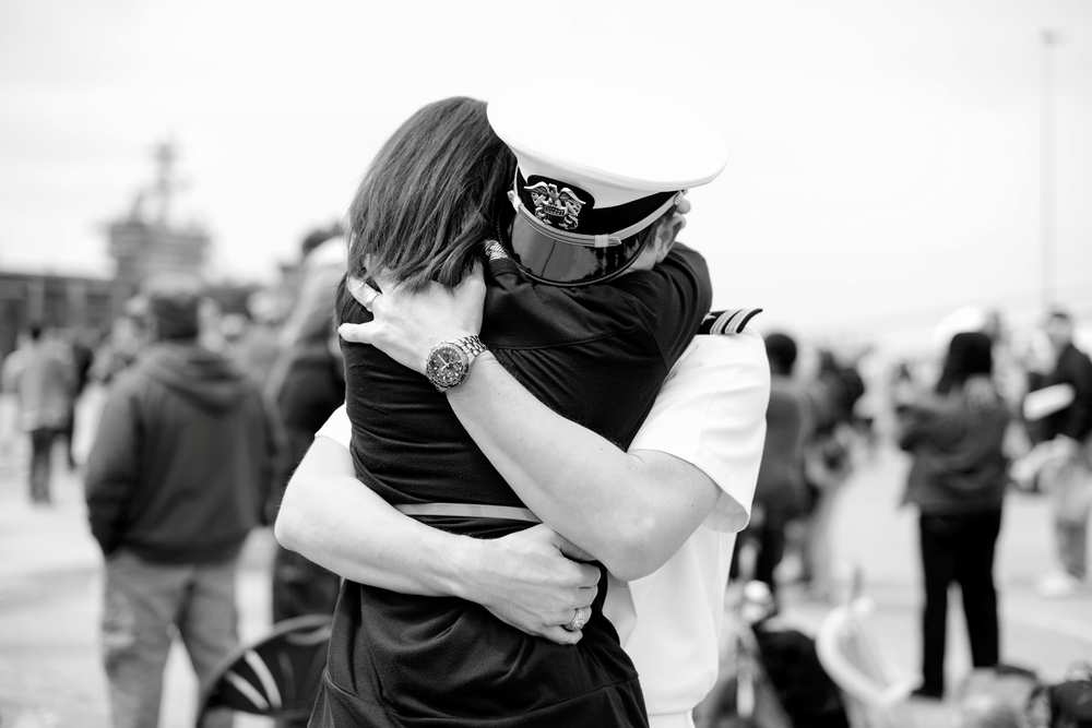 A wife is reunited with her husband after a 9 month deployment | USS Truman Navy Military Homecoming | Maria Grace Photography