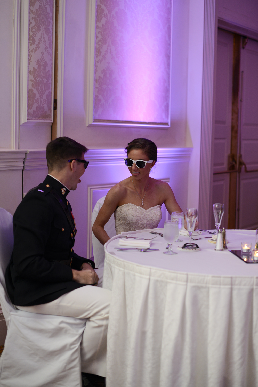 Bride and groom share special moment at their reception with sunglasses on | Maria Grace Photography