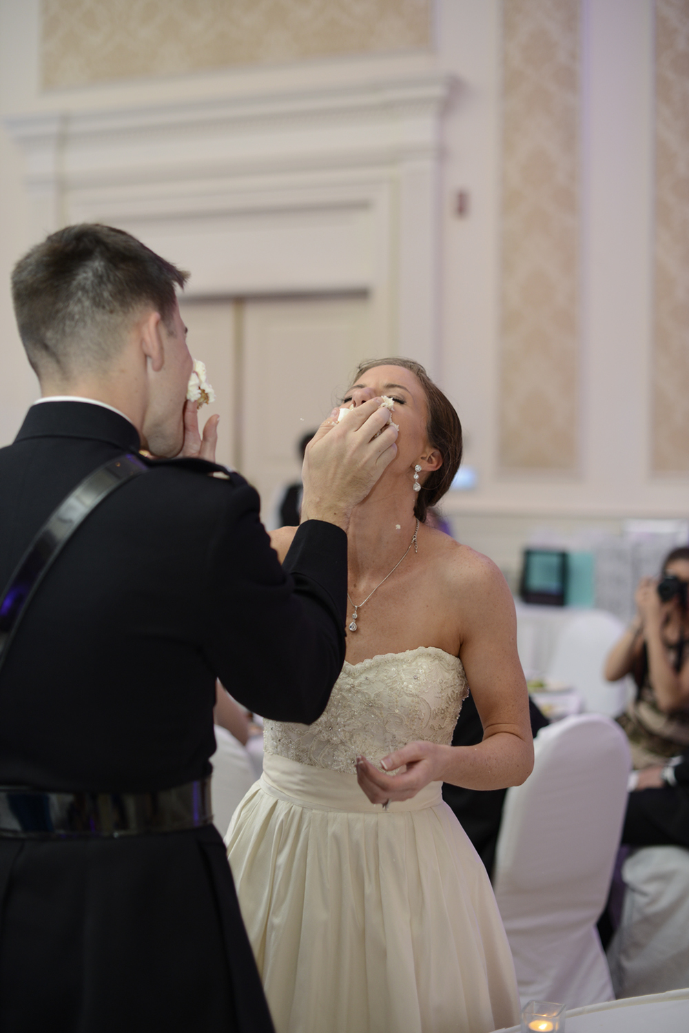 Bride and groom smash cake in their faces! | Maria Grace Photography