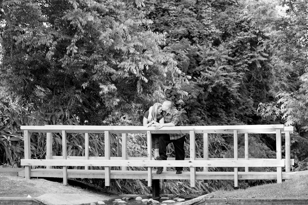 Beautiful Colonial Williamsburg engagement on a bridge over a pond | Maria Grace Photography