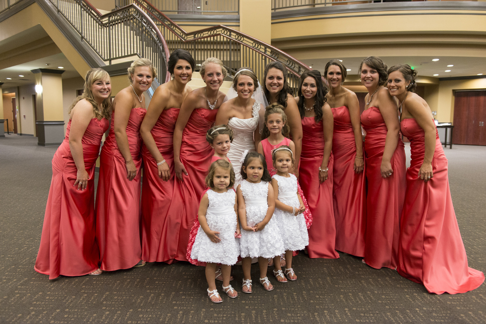 Bridesmaids in bright coral dresses at Liberty Baptist Church