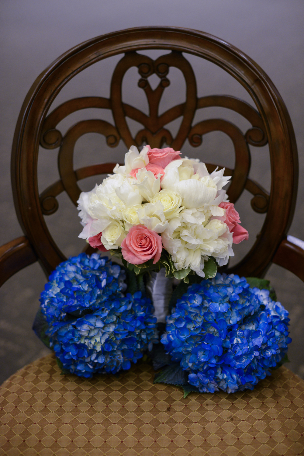 White rose bridal bouquet and blue hydrangea bridesmaids bouquet