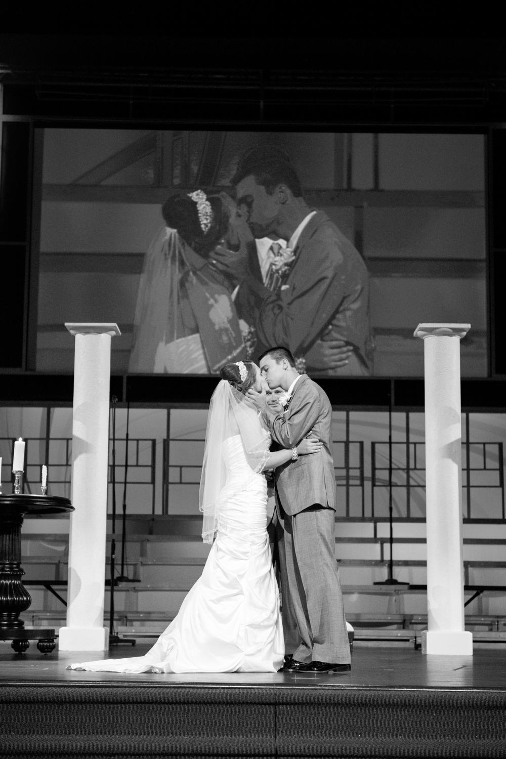 First wedding kiss in black and white at Liberty Baptist Church in Hampton, Virginia