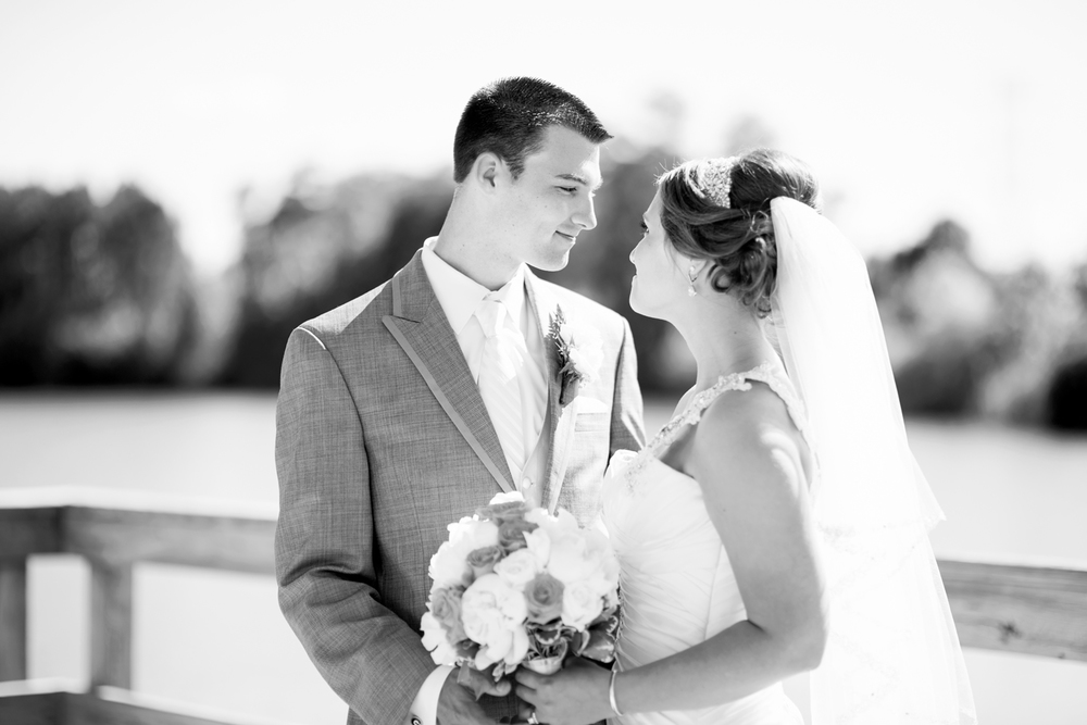 Bride and groom portrait on a pier by the water in Suffolk, Virginia, black and white