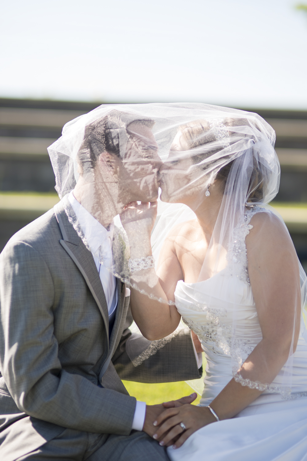 Bride and groom portrait under the veil by the water in Suffolk, Virginia