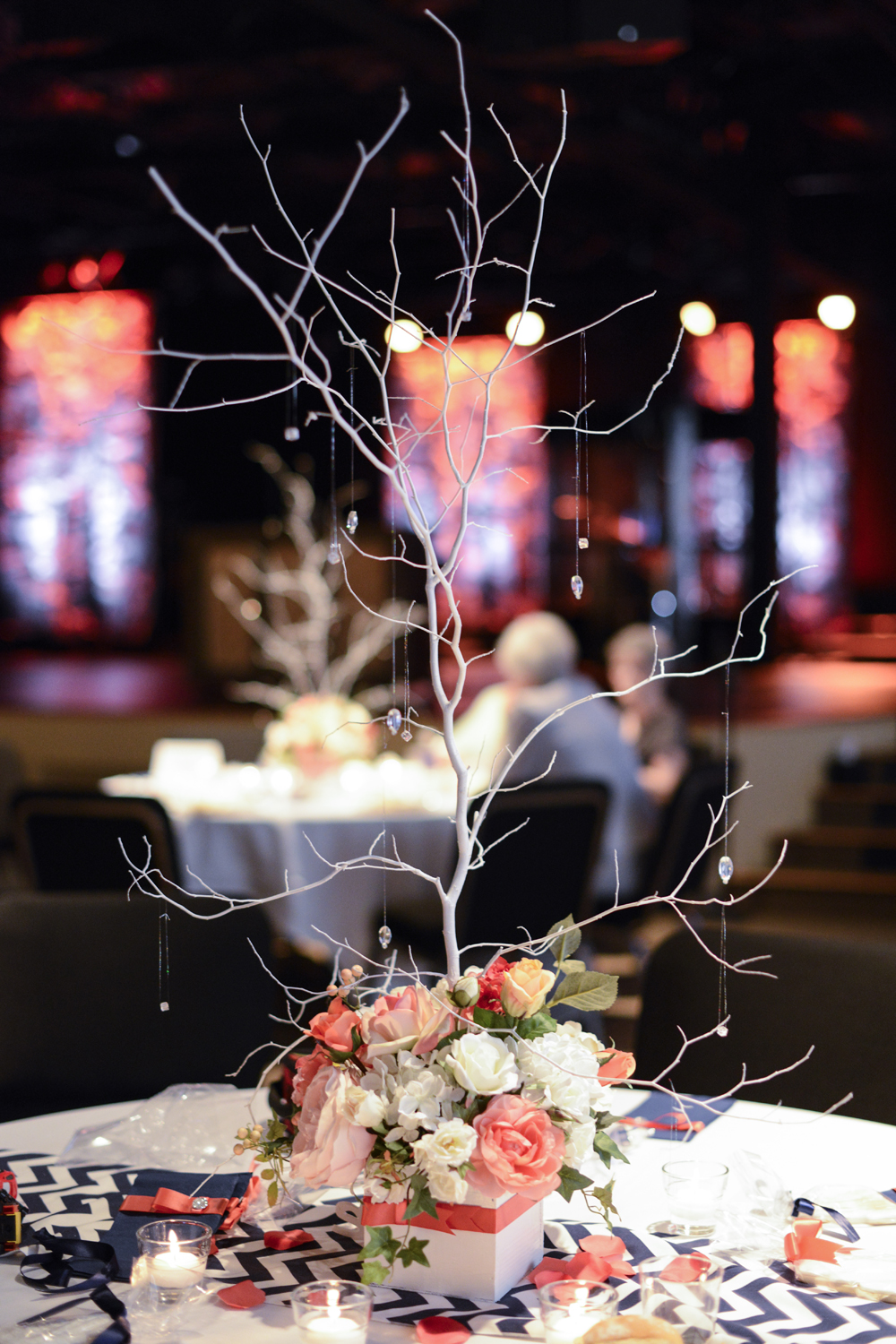 Twig and rose coral pink centerpiece at wedding reception