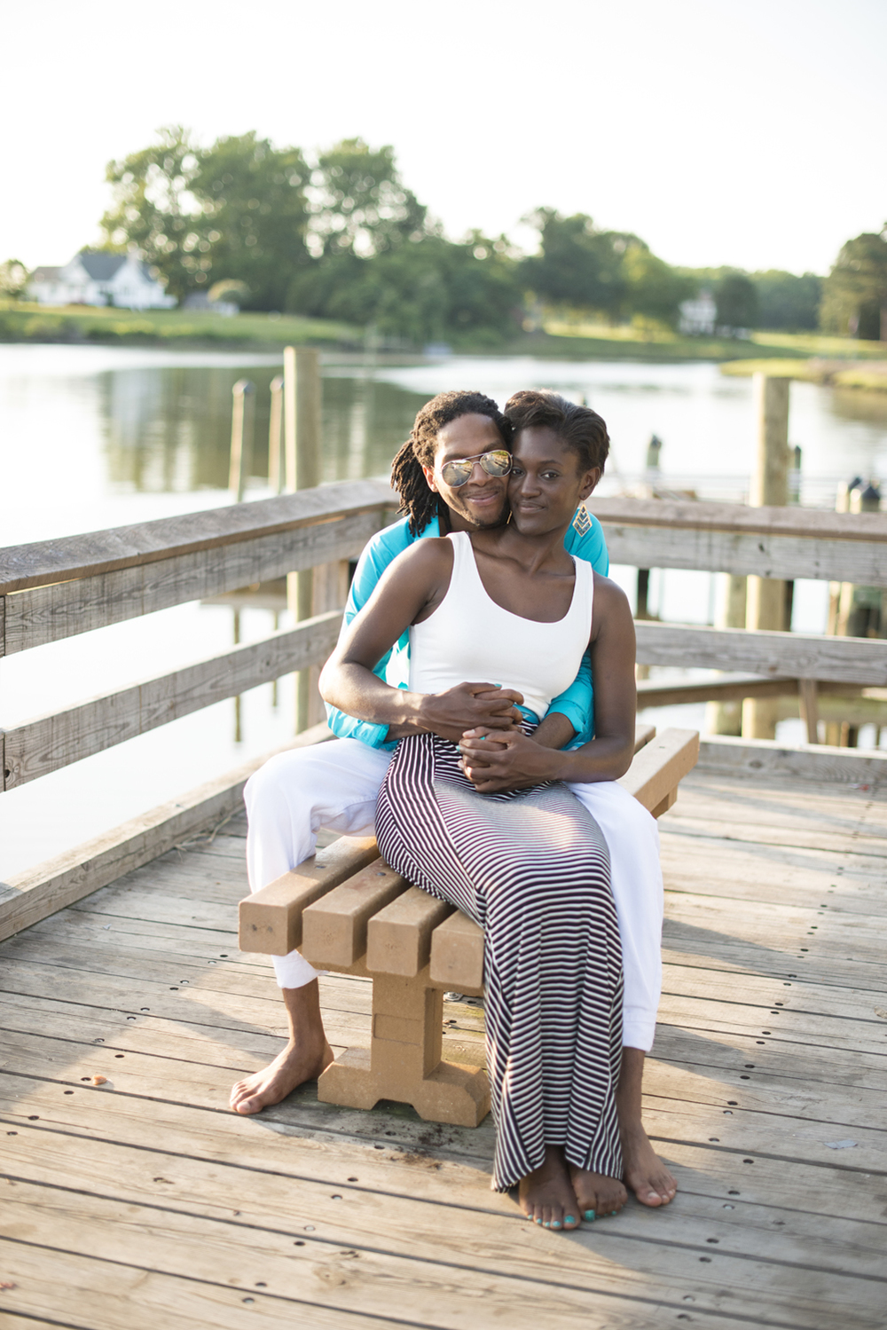 Anniversary portrait session at sunset on a pier by the water of Suffolk, Virginia