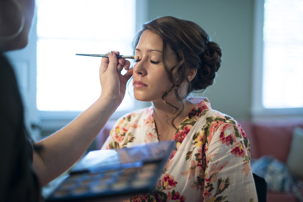 Bride getting her makeup done on her wedding day  | Portsmouth Woman's Club in Virginia
