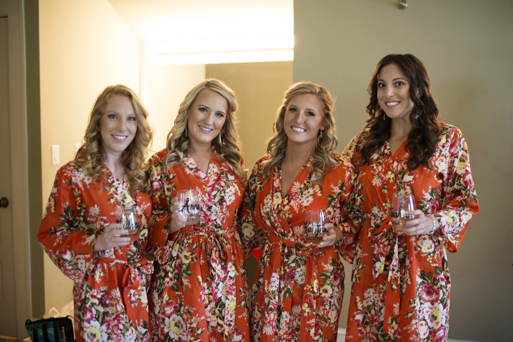 Bridesmaids in bright orange flower robes  | Portsmouth Woman's Club in Virginia