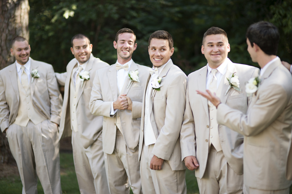 Groomsmen portraits in creamy white tuxedos  | Portsmouth Woman's Club in Virginia