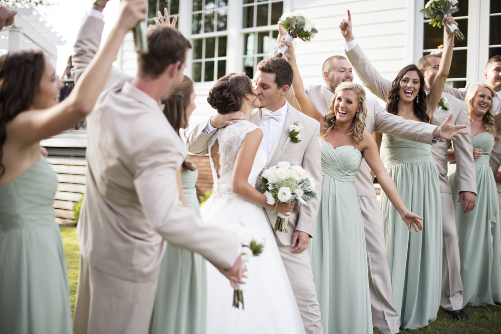 Bridal party cheering pictures in mint green dresses and cream white suits  | Portsmouth Woman's Club in Virginia