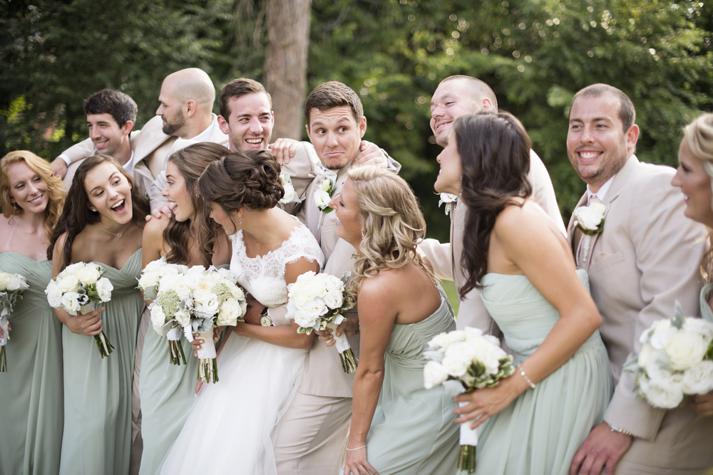 Bridal party pictures in mint green dresses and cream white tuxedos  | Portsmouth Woman's Club in Virginia