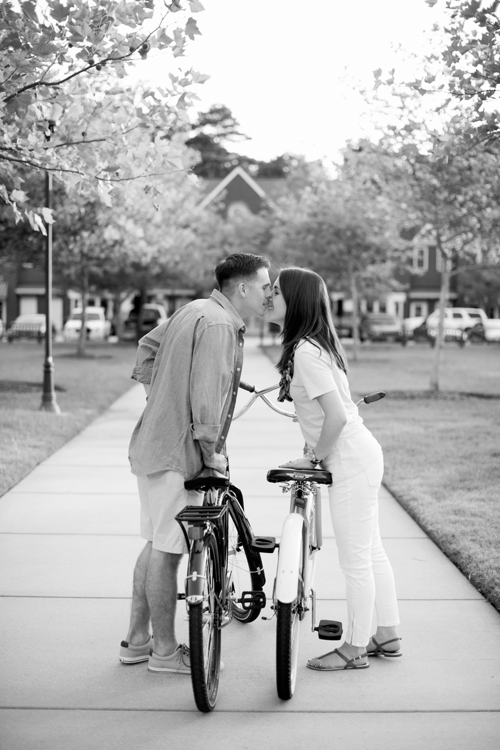 Classic black and white of a couple kissing with their beach cruisers  in   Port Warwick, Newport News, Virginia