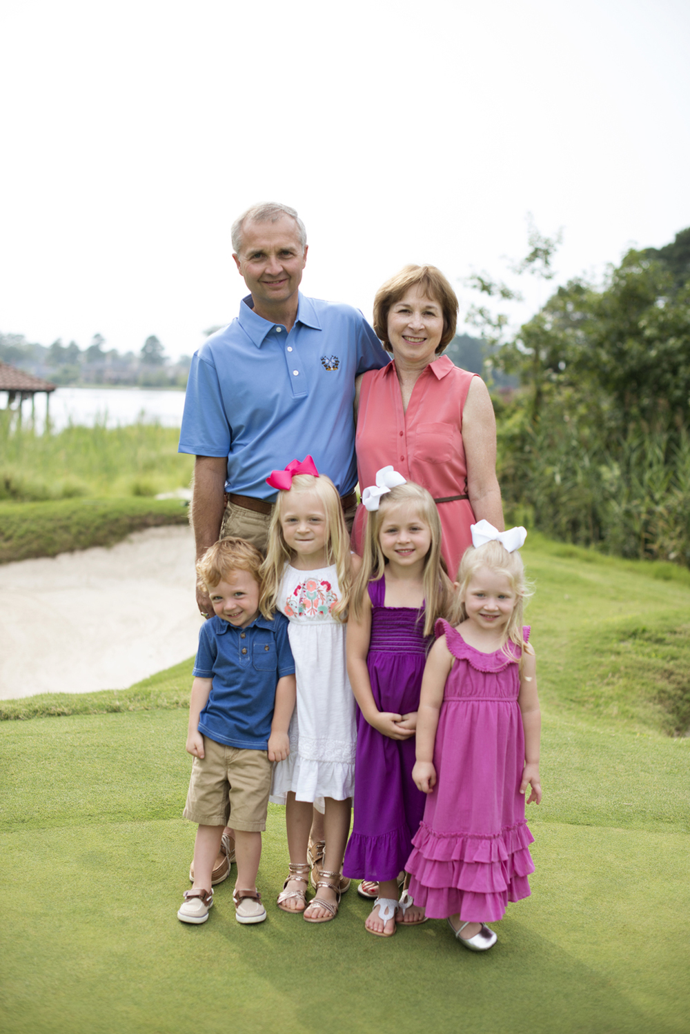Pink and blue family portraits at Princess Anne Country Club Golf Course in Virginia Beach