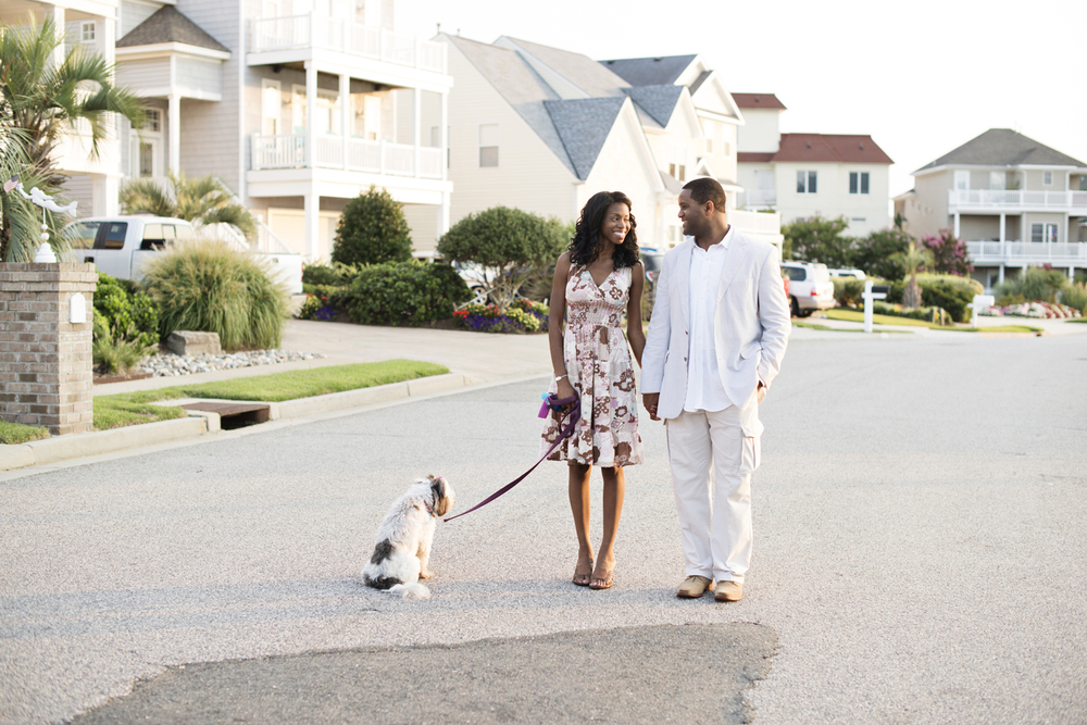Sunrise  engagement portraits on a neighborhood street in East Beach in Norfolk, Virginia