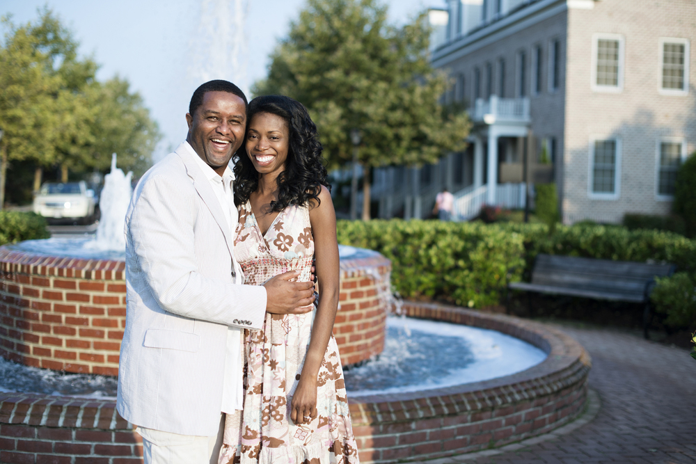 Sunrise engagement portraits in front of a fountain at East Beach in Norfolk, Virginia