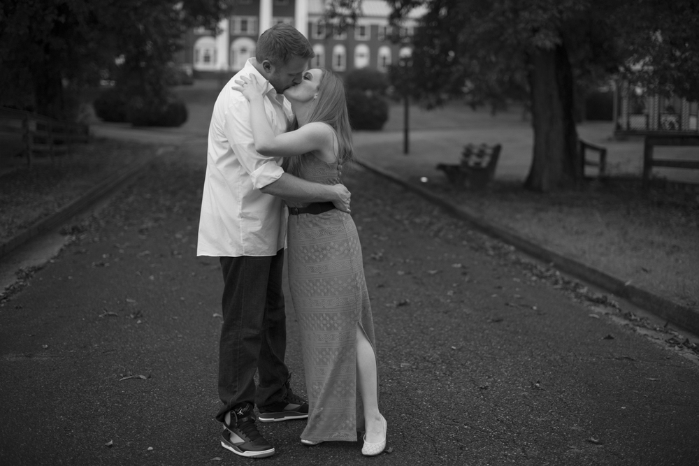 A sweet kiss during beautiful engagement pictures in Downtown Staunton, Virginia (black and white)
